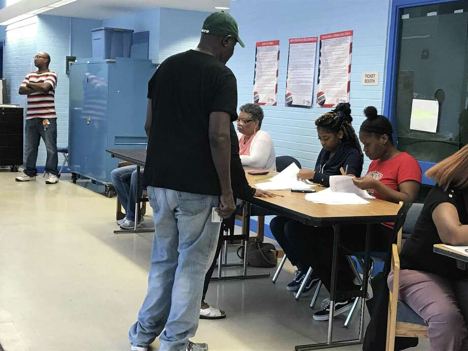 Voting at Lincoln Basset in New Haven on Tuesday morning, Aug. 14, 2018. Photo: Jessica Lerner / Hearst Connecticut Media / New Haven Register