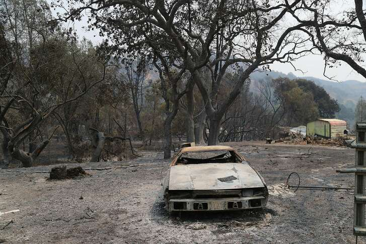 A destroyed vehicle on burned property after the Ranch fire burned through the area, in the Spring Valley community near Clearlake, Calif., Aug. 8, 2018. The Mendocino Complex fire system, a combination of the Ranch fire and the River fire, has grown to more than 300,000 acres. Billowing smoke from the historic wildfire season has caused hazardous air conditions across the state, prompting air quality alerts and forcing many residents to take refuge indoors to avoid unhealthy exposure to bad air. (Jim Wilson/The New York Times)