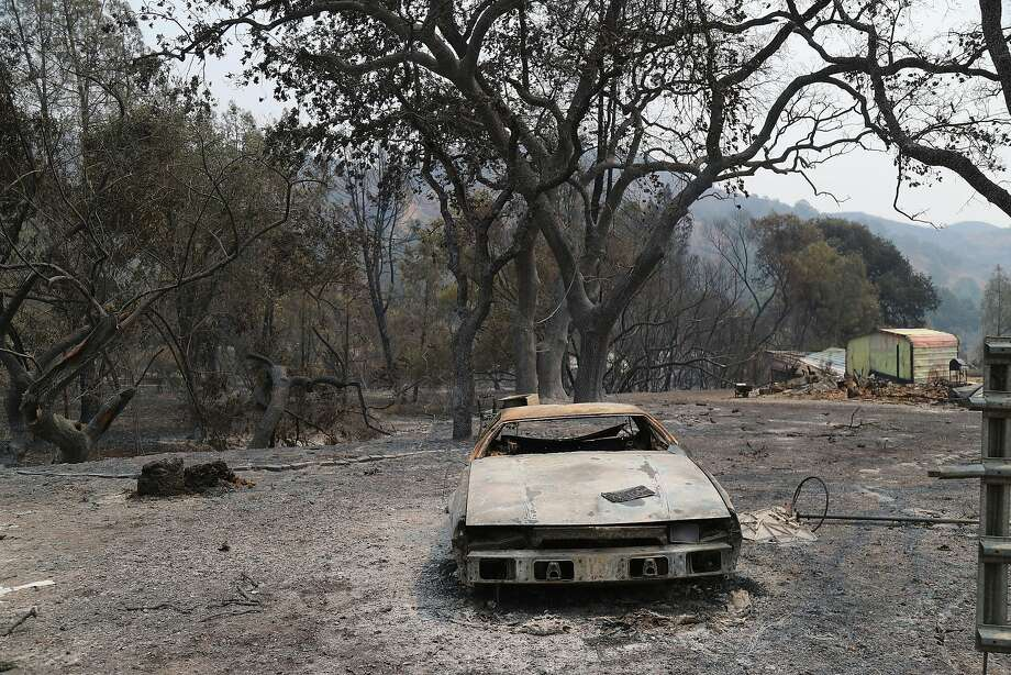 A destroyed vehicle on burned property after the Ranch fire burned through the area, in the Spring Valley community near Clearlake, Calif., Aug. 8, 2018. The Mendocino Complex fire system, a combination of the Ranch fire and the River fire, has grown to more than 300,000 acres. Billowing smoke from the historic wildfire season has caused hazardous air conditions across the state, prompting air quality alerts and forcing many residents to take refuge indoors to avoid unhealthy exposure to bad air. (Jim Wilson/The New York Times) Photo: JIM WILSON;Jim Wilson / New York Times