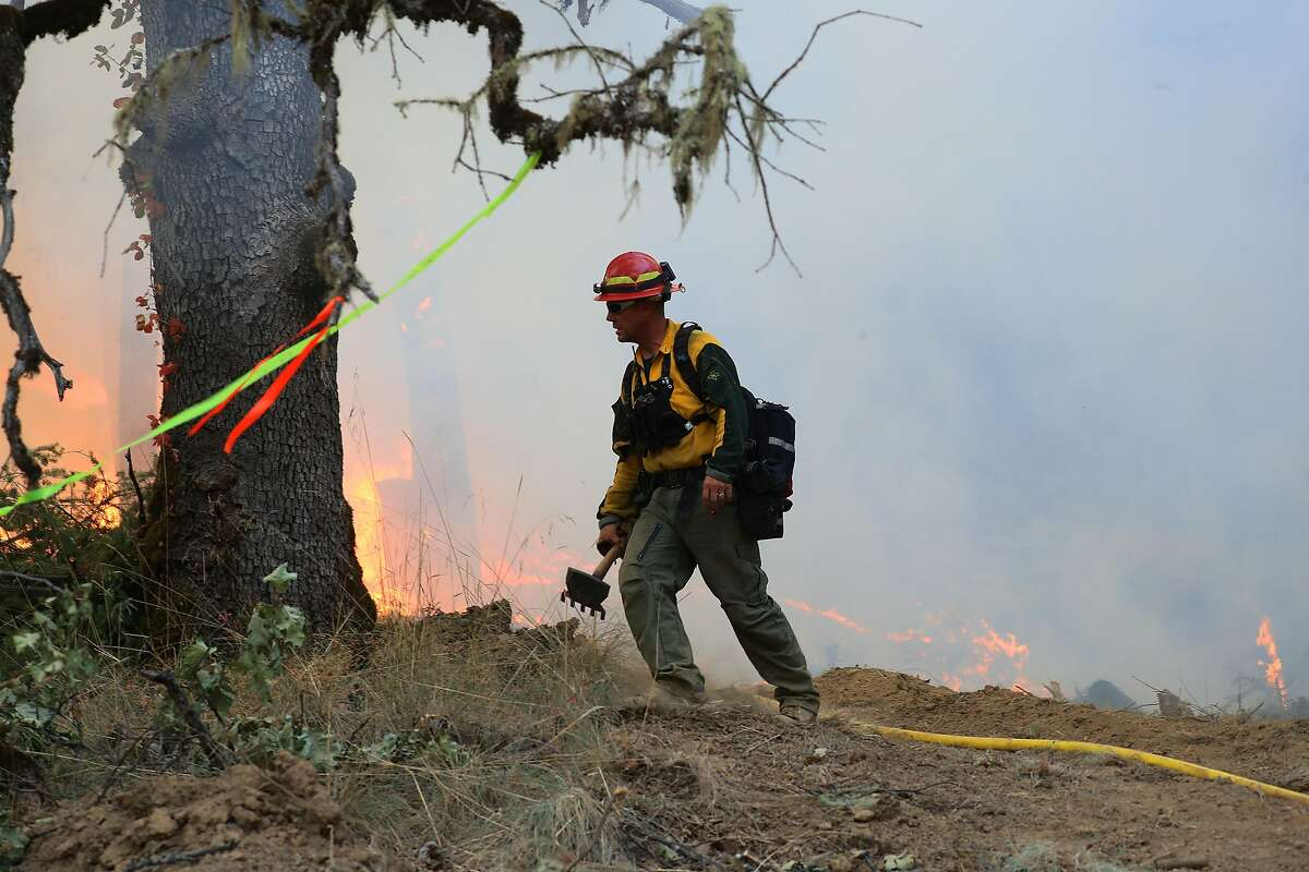 A firefighter lights a backfire in efforts to contain the Ranch fire near Potter Valley, Calif., Aug. 9, 2018. The Mendocino Complex fire system, a combination of the Ranch fire and the River fire, has grown to more than 300,000 acres. (Jim Wilson/The New York Times)