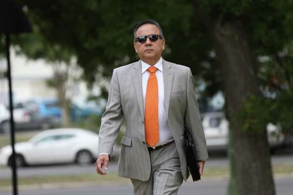Former Texas Star Senator and now convicted felon Carlos Uresti arrives at the John H. Wood, Jr. U. S. Courthouse for a pension hearing, Tuesday, August 14, 2018. Uresti's hearing before Senior U.S. District Judge David Ezra is to request to start receiving his state pension. Uresti estimated he expects to receive more than $80,000 a year from the pension. The government is opposing the request and say Uresti wants to keep assets that should go to the victims of his crimes. Uresti was sentenced in June to 12 years in prison and ordered to pay his victims $6.3 million in restitution.