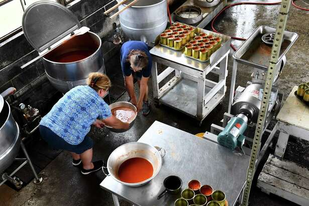 Sisters Carolyn Robertson, left, and Susan Franklin work to fill 159 quart-size cans of homemade soup at the Glade Hill Cannery in Virginia.