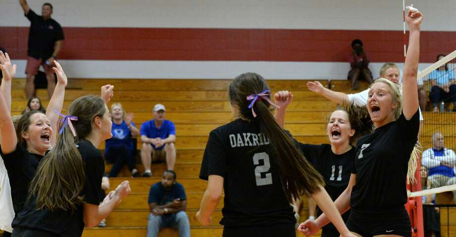 The Oak Ridge team celebrates the winning point of the Gold Bracket championship match between the Oak Ridge War Eagles and the Klein Bearkats during the of the 2018 Katy / Cy-Fair Volleyball Classic on August 11, 2018 at Katy High School, Katy, TX. Photo: Craig Moseley/Staff Photographer