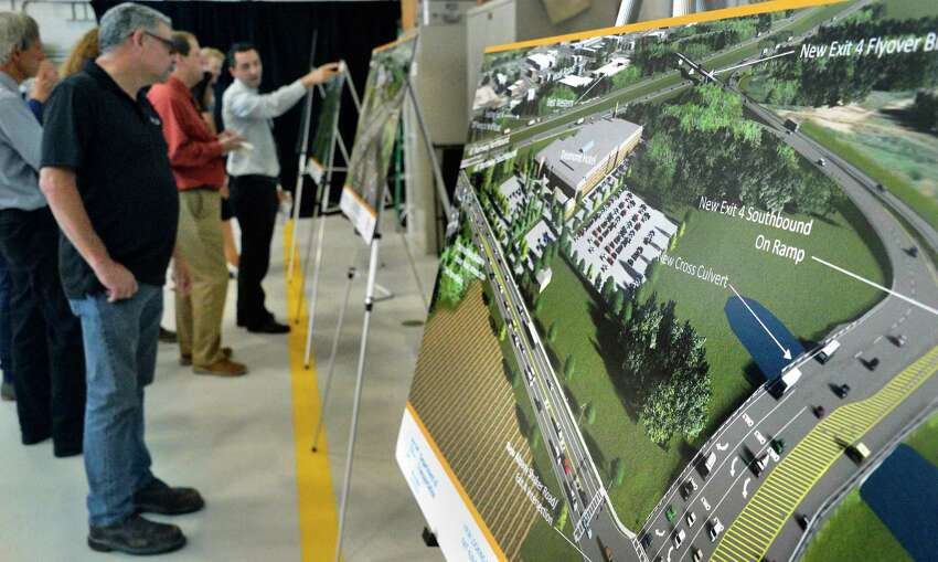 Artist concepts of a $72 million investment in the Capital Region that will connect I-87 motorists directly with Albany Airport via Exit 4, a new parking garage and other improvements on display during a news conference at the airport Tuesday August 14, 2018 in Colonie, NY. (John Carl D'Annibale/Times Union)