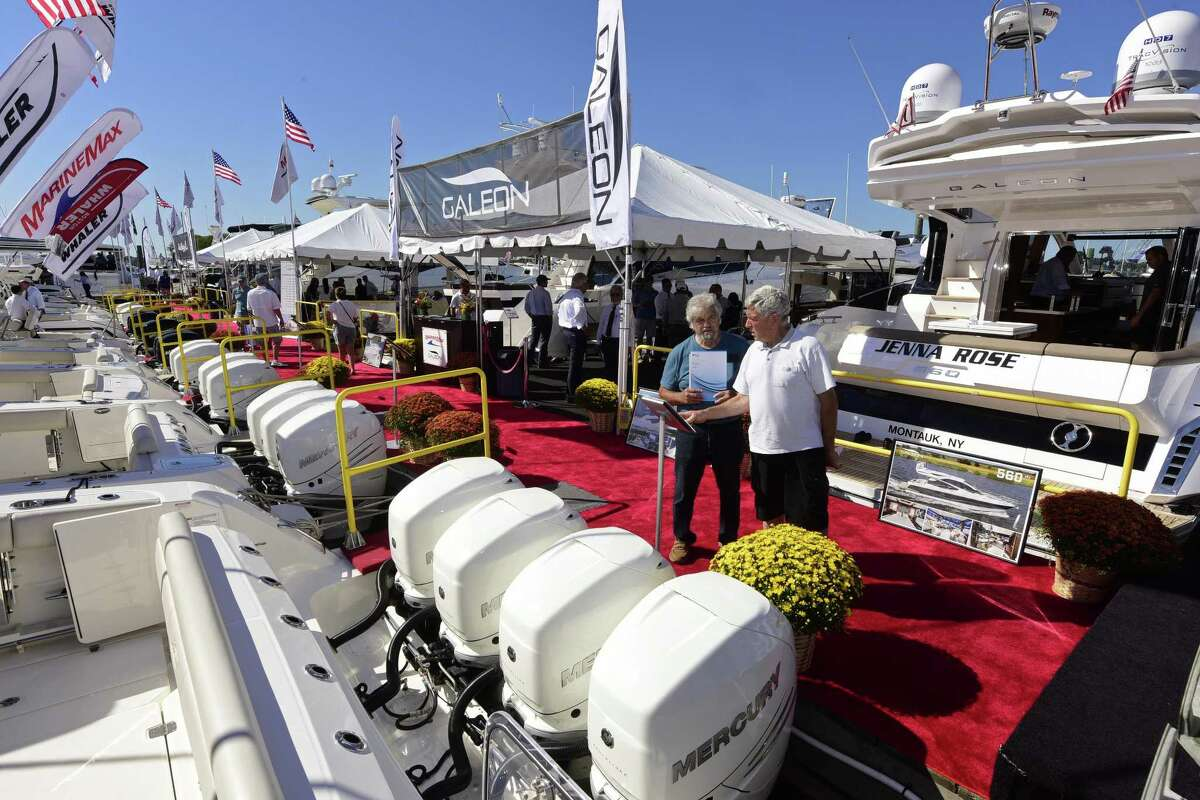 William Tryon and Richard Silva examine a Boston Whaler at the 2016 installment of the Norwalk Boat Show at Cove Marina in Norwalk, Conn.