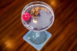 The Violet Skies, made with a mix of Del Amigo Mezcal, Equatorial Gin, Ventura Strawberry Brandy , Kalani Coconut, Rothman & Winter Crem� de Violette, Lemon, is served at Violet's Tavern in San Francisco, Calif. on Friday, August 10, 2018.