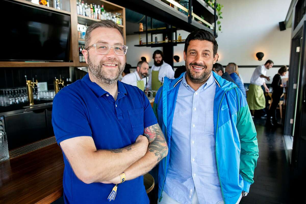 Co-Owners Boris Nemchenok and Brandon Gillis Brandon Gillis stand for a portrait inside Violet's Tavern in San Francisco, Calif. on Friday, August 10, 2018.