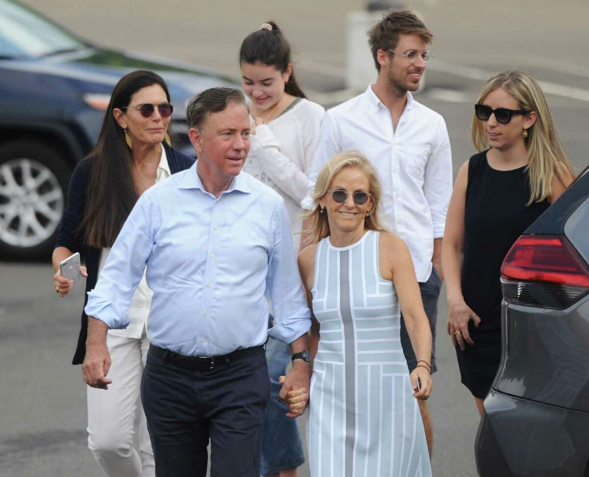 Democratic-endorsed gubernatorial candidate Ned Lamont and his wife, Annie, and family enter the Greenwich District 7 polling center to vote in the primary election at Greenwich High School in Greenwich, Conn. Tuesday, Aug. 14, 2018.