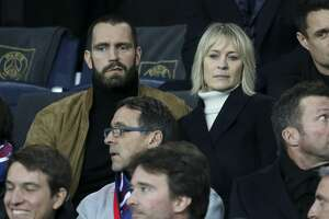 PARIS, FRANCE - MARCH 6: Robin Wright and Clement Giraudet attend the UEFA Champions League Round of 16 Second Leg match between Paris Saint-Germain (PSG) and Real Madrid at Parc des Princes stadium on March 6, 2018 in Paris, France. (Photo by Jean Catuffe/Getty Images)