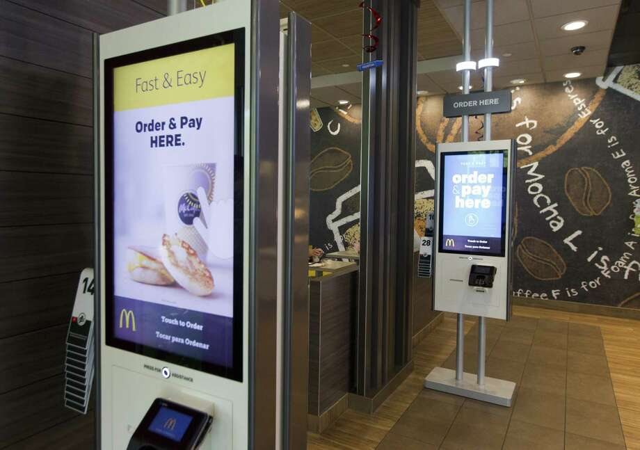 McDonald's new ordering kiosks are seen as part of the company's $448 million investment to modernize and improve customer experience across more than 840 locations in Texas. Photo: Jason Fochtman, Staff Photographer / Houston Chronicle / © 2018 Houston Chronicle