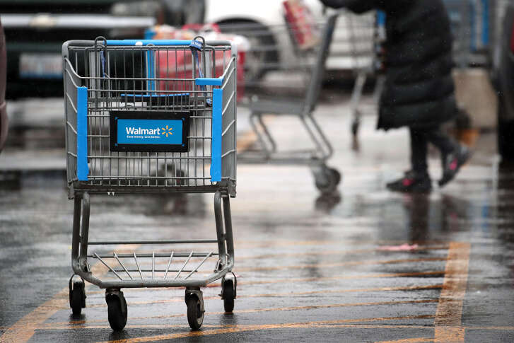 CHICAGO, IL - JANUARY 11: A shopping cart sits outside of a Walmart store on January 11, 2018 in Chicago, Illinois. Walmart announced today it would use savings from the recently revised tax law to increase their starting wage to $11-per-hour, offer some hourly employees a one-time bonus up to $1000, expand maternity and parental leave benefits and will begin to offer adoption assistance. The company also disclosed today that it would be closing 63 of its Sam's Club stores across the US, costing thousands of workers their jobs. (Photo by Scott Olson/Getty Images)
