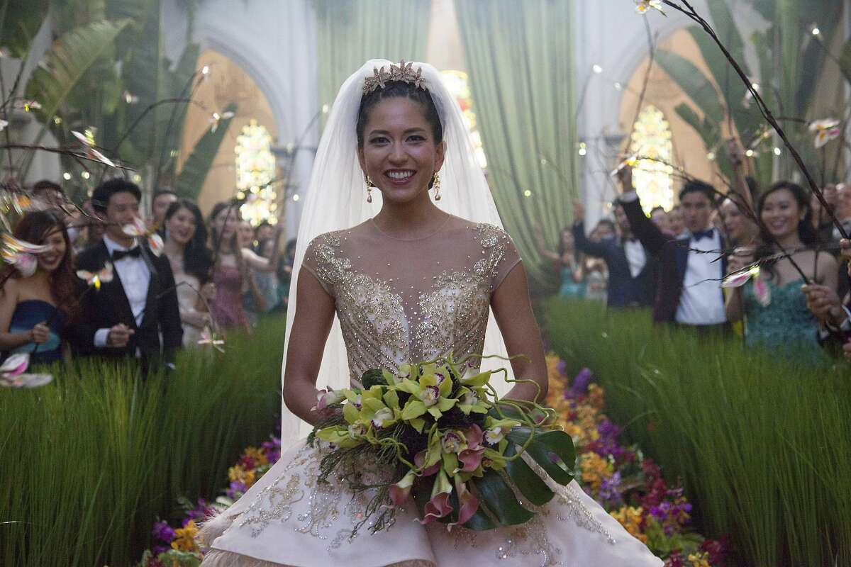 """This image released by Warner Bros. Entertainment shows Sonoya Mizuno in a scene from the film """"Crazy Rich Asians."""" (Sanja Bucko/Warner Bros. Entertainment via AP)"""