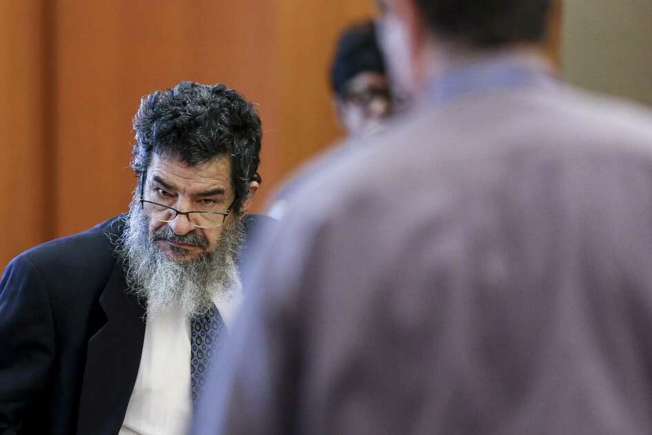 "Ali Mahwood-Awad Irsan, left, stands during a break in testimony in his capital murder trial at the Harris County Civil Courthouse Thursday Aug. 9, 2018 in Houston. Irsan is accused of orchestrated two separate but related ?""honor killings?"" in 2012."