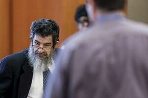 """Ali Mahwood-Awad Irsan, left, stands during a break in testimony in his capital murder trial at the Harris County Civil Courthouse Thursday Aug. 9, 2018 in Houston. Irsan is accused of orchestrated two separate but related """"honor killings"""" in 2012."""