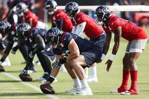 Houston Texans quarterback Deshaun Watson (4) lines up under center Nick Martin (66) during training camp at the Methodist Training Center on Tuesday, Aug. 14, 2018, in Houston.