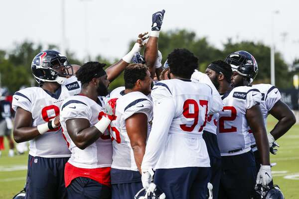 Houston Texans defensive linemen huddle up during training camp at the Methodist Training Center on Tuesday, Aug. 14, 2018, in Houston.
