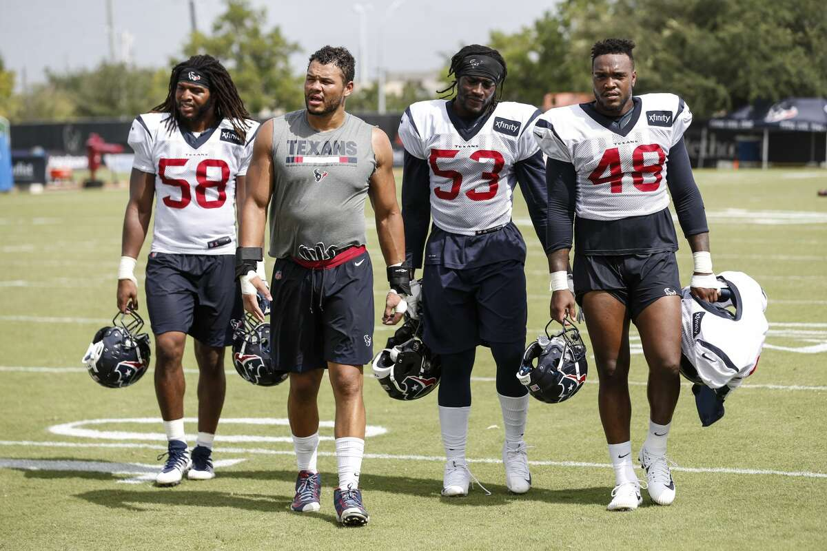 Houston Texans linebackers Peter Kalambayi (58), Brennan Scarlett, Duke Ejiofor (53) and Davin Bellamy (48) walk off the practice field following practice during training camp at the Methodist Training Center on Tuesday, Aug. 14, 2018, in Houston.
