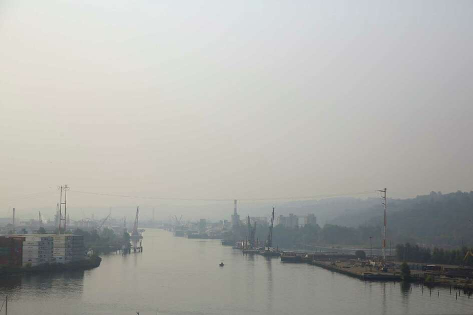 Wildfire smoke causes a thick haze over the Duwamish River south of the West Seattle Bridge, Tuesday, Aug. 14, 2018.