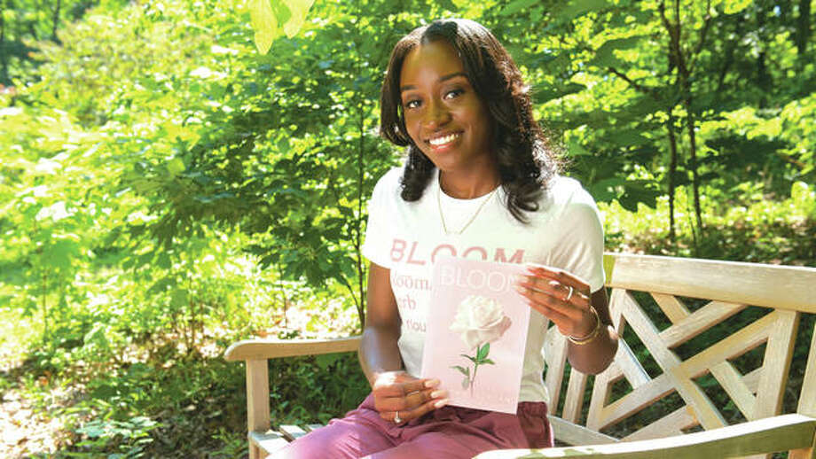 "SIUE senior Corinthia Jordan holds her self-published book of poetry entitled ""Bloom."" Photo:       SIUE Photo"
