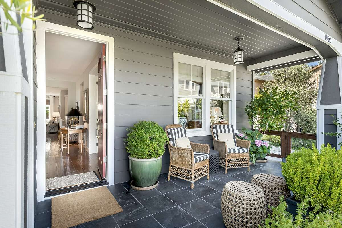 A covered tile porch stretches before the Yountville home.