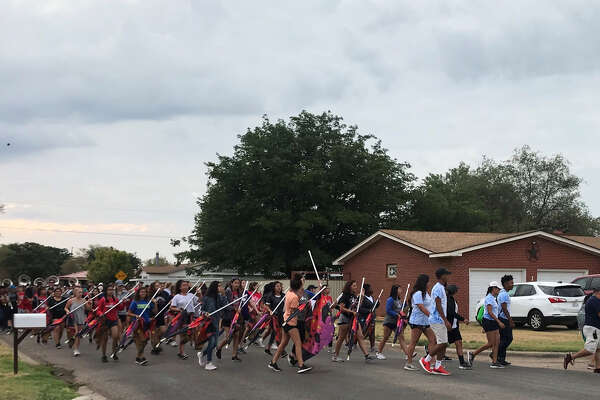 The Plainview High School Powerhouse of the Plains Marching Band took to the streets Saturday to raise money for a trip to New York next summer.
