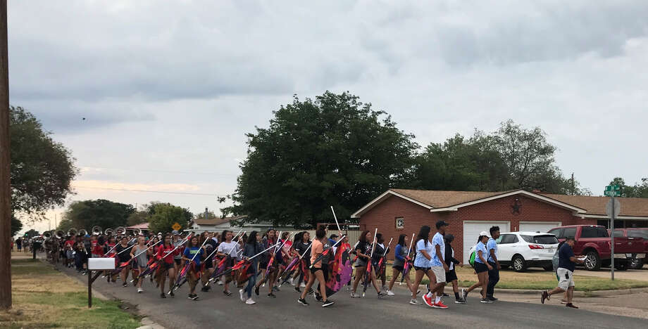 The Plainview High School Powerhouse of the Plains Marching Band took to the streets Saturday to raise money for a trip to New York next summer. Photo: JoAnn Rey