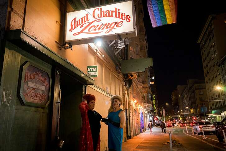 Olivia Hart (left) and Collette LeGrande talk in front of Aunt Charlie's Lounge in the Tenderloin neighborhood of San Francisco, Calif. on Saturday, August 11, 2018.