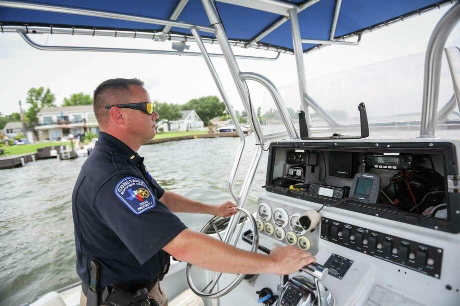 Precinct 1 Constable's Lt. Tim Cade scans the horizon while traveling across Lake Conroe. Photo: Michael Minasi, Staff Photographer / Houston Chronicle / © 2018 Houston Chronicle