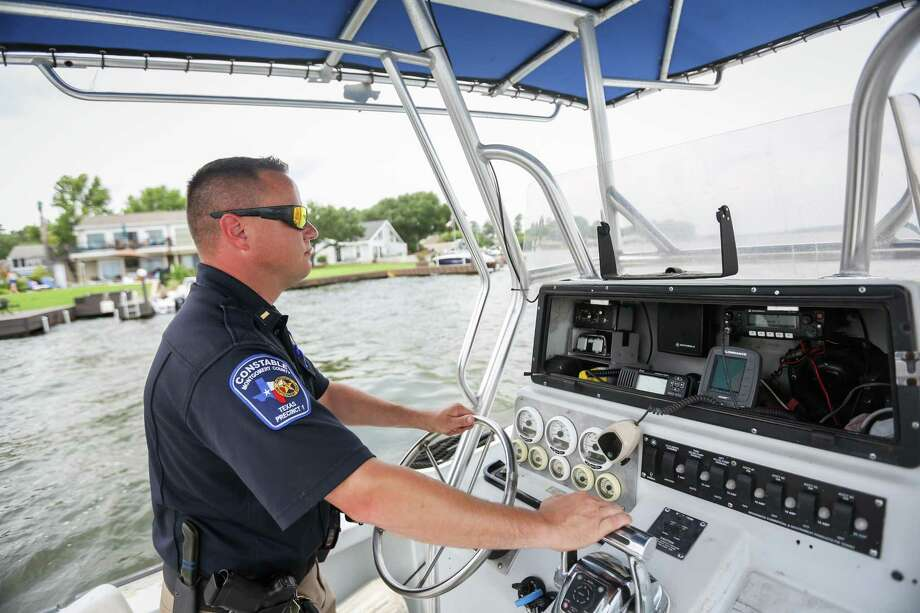 Precinct 1 Constable's Lt. Tim Cade scans the horizon while traveling across Lake Conroe on Monday, June 4, 2018. Photo: Michael Minasi, Staff Photographer / Houston Chronicle / © 2018 Houston Chronicle
