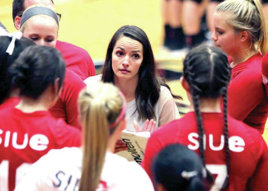 The SIUE volleyball team of coach Kendall Paulus, center, has been picked to finish third in the Ohio Valley Conference for the 2018 season by a vote of the league's coaches and sports information directors. Photo:       SIUE Athletics