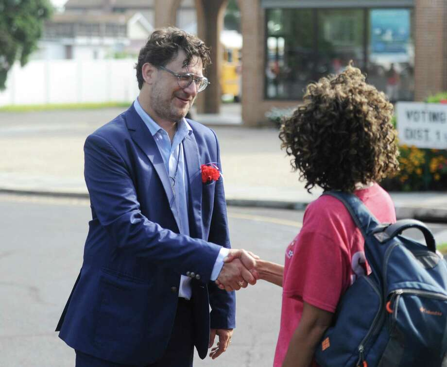 Democratic Party-endorsed State Rep. candidate David Michel, of District 146, talks with primary election voters outside the Stamford District 1 polling center at Our Lady Star of the Sea in Stamford, Conn. Tuesday, Aug. 14, 2018. Photo: Tyler Sizemore / Hearst Connecticut Media / Greenwich Time