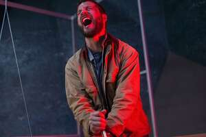 """Logan Marshall-Green's personal assistant is inside his head — and can take over his body — in the in the sci-fi/horror film """"Upgrade."""""""