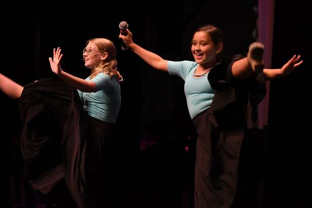 "Ella Agnew, 12, left, and Adley Zalewski, 12, both 7th graders at Riverwood Middle School, perform a Broadway jazz dance to ""Singin' in the Rain"" during the ""Lake Houston's got Talent Show"" at The Nathaniel Center in Kingwood on August 10, 2017. (Photo by Jerry Baker/Freelance)"