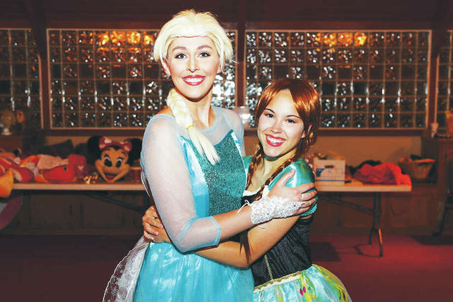 "Fifteen talented girls recently auditioned to be in the ""Frozen"" chorus at the Disney character brunch and received invitations to join ""Elsa,"" left, and ""Anna,"" right, on stage to sing at this weekend's ""A Magical Evening with Disney."" Photo:       Photo Credit Pete Basola
