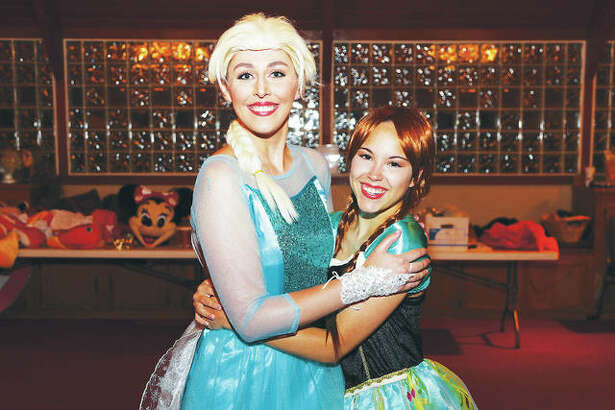 """Fifteen talented girls recently auditioned to be in the """"Frozen"""" chorus at the Disney character brunch and received invitations to join """"Elsa,"""" left, and """"Anna,"""" right, on stage to sing at this weekend's """"A Magical Evening with Disney."""""""