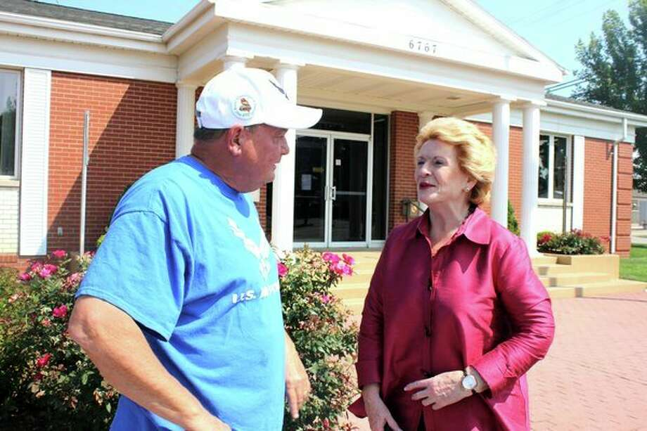 U.S. Sen. Debbie Stabenow, a Michigan Democrat, toured businesses in downtown Caseville on Monday. She is pictured with Steve Louwers, president of the Caseville Chamber of Commerce and event coordinator for the Cheeseburger in Caseville Festival. Stabenow greeted constituents along Main Street and bought a cheeseburger from MQS Pizza Express, the winner of the festival's 2018 Best Cheeseburger contest. (Brenda Battel/Huron Daily Tribune)