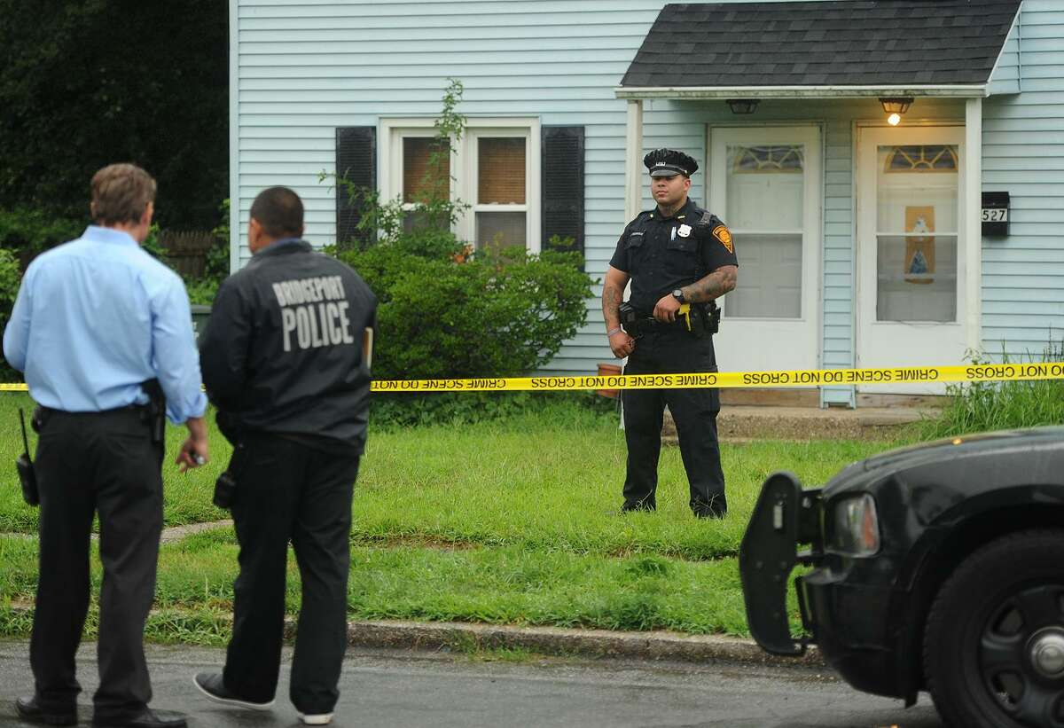Bridgeport Police on Pearl Harbor Street in Bridgeport on Monday. Martha Thomas, 54, was found in her duplex apartment and Police sources said there were signs of a struggle.