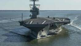The USS Gerald R. Ford embarks on the first of its sea trials in 2017 to test various state-of-the-art systems on its own power for the first time, from Newport News, Va. However, Chinese innovations in artificial intelligence make such ships vulnerable.
