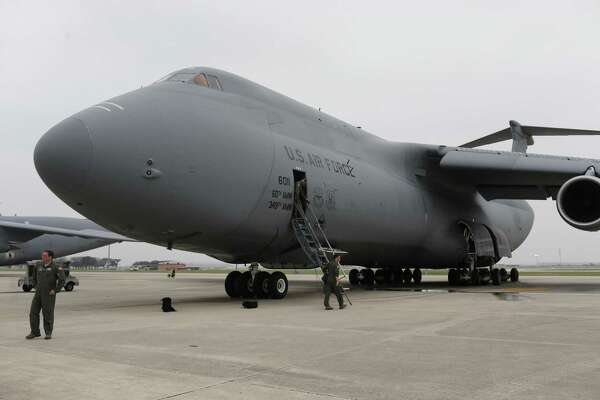 Air Force Reserve crewmembers board a C5-M Super Galaxy before a 2017 flight at Joint Base San Antonio-Lackland. A video has surfaced of the Air Force's largest cargo plane making a rare landing without its nose gear in March in San Antonio.
