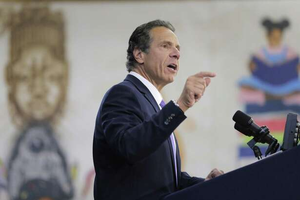 In this July 5, 2018, file photo, New York Gov. Andrew Cuomo speaks at an event in the Brownsville section of Brooklyn, N.Y. New York state has sued Purdue Pharma for alleged deceptive marketing of its opioids, including OxyContin.