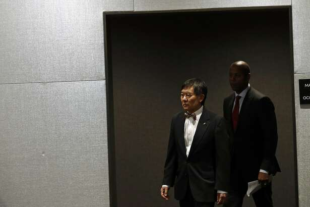 University of Maryland president Wallace Loh, left, and athletic director Damon Evans arrive at a news conference held to address the school's football program and the death of a player who collapsed on a practice field, Tuesday, Aug. 14, 2018, in College Park, Md. (AP Photo/Patrick Semansky)