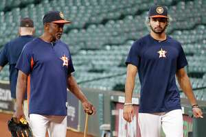 Houston Astros third base coach Gary Pettis, left, with his son, Dante Pettis, who was the second round draft pick for the San Francisco 49'rs during batting practice before the start of an MLB game at Minute Maid Park, Tuesday, August 14, 2018, in Houston.