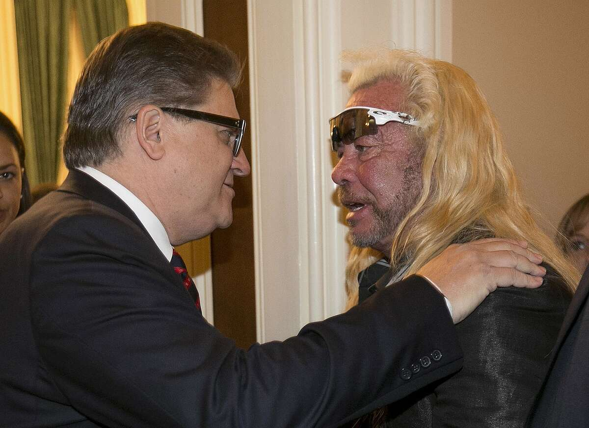 FILE -- In this April 18, 2017 file photo, state Sen. Robert Hertzberg, D-Van Nuys, left, talks with reality show star Duane