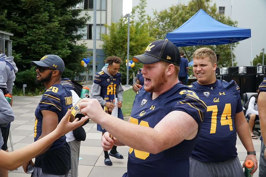 Sophomore right guard Michael Saffell makes sure students moving into the Cal dorms have football schedules. Photo: Jared Prescott / Cal Athletics