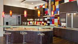 Tempered glass countertops not only provide transparency, but, when installed with LED lights along the outside edge, illumination, too. The lights can be programmed to emit different colors and the glass surface can be etched with swirls, geometric shapes of other designs. Because of their cost, about $250 per square foot, glass is often used as a highlight rather than as the main countertop surface.