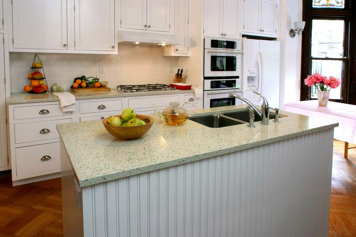 3of 9Recycled Glass Countertops Give Kitchens A Distinctive Speckled Look.  This Installation Consists Of Sage Green Glass, Clear Glass And Mother Of  Pearl ...