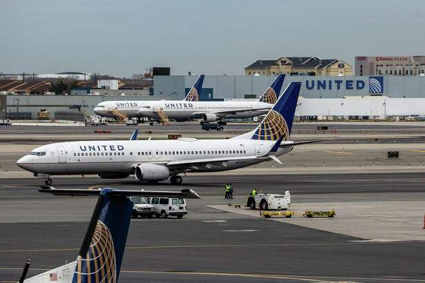 United Airlines airplanes sit outside the company's hangar in Newark, New Jersey. MUST CREDIT: Bloomberg photo by Timothy Fadek