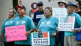 Members of Working Texans for Paid Sick Time rally in front of City Hall before the City Council meets to ratify signatures to get a proposed paid sick leave ordinance on the November ballot on Thursday, Aug. 2, 2018.
