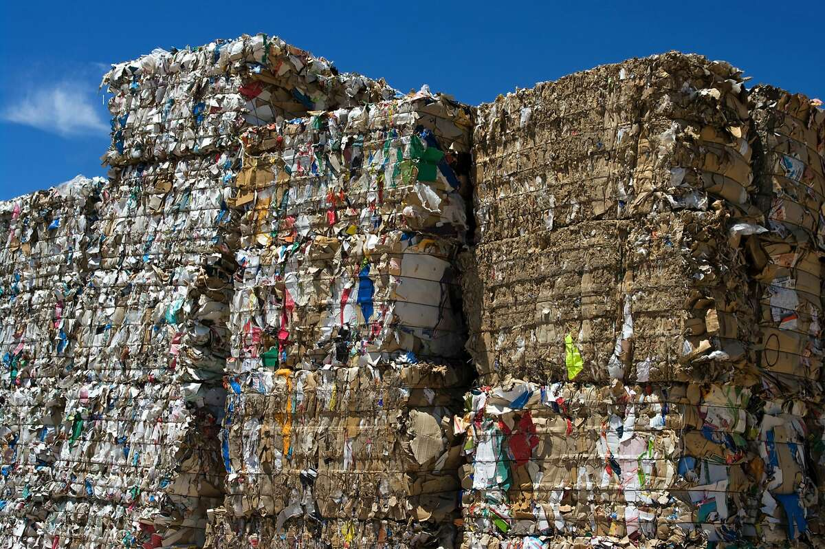 Stacked paper bales set for recycling on June 23, 2009. When China enacted much stricter standards for the quality of paper that it accepts for recycling, only allowing a contamination rate of a half-percent or lower, it effectively cut off China as a destination for the material. (Huguette Roe/Dreamstime/TNS)
