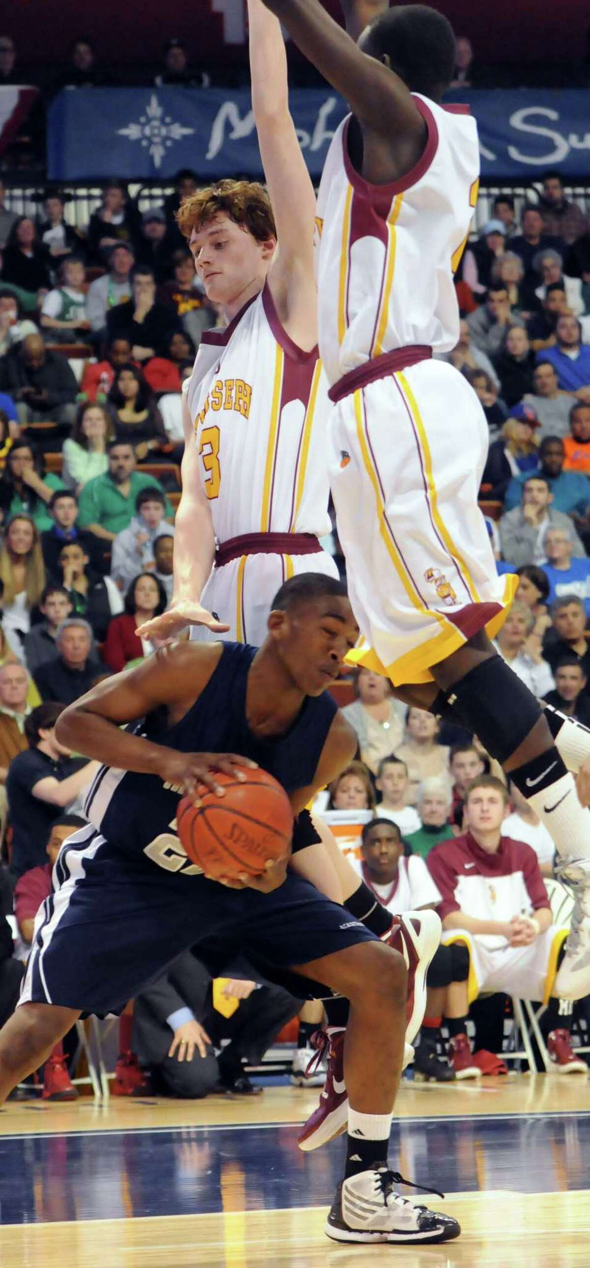 Raiquan Clark head fakes a pair of St. Joseph defenders in the 2012 Class LL championship game. Photo by Mara Lavitt/New Haven Register 3/17/12